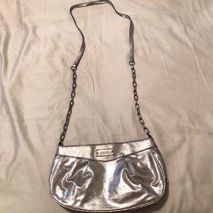 Shimmery cross body bag from Mango